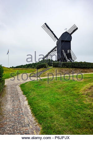 Black wooden windmill at Vesting Bourtange, the star-shaped fortress in Groningen Province, The Netherlands - Stock Image