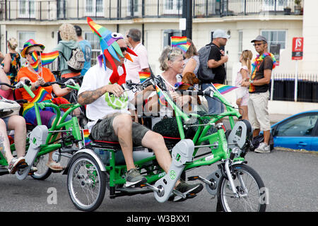 WORTHING, UK - JULY 13, 2019: People celebrate Gay Pride Parade event in seaside town of Worthing - Stock Image