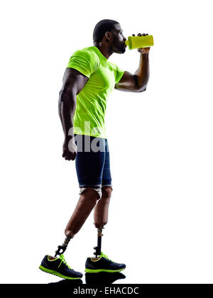 one muscular handicapped man with legs prosthesis in silhouette on white background - Stock Image
