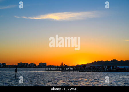 Sunset over the Swan River, Perth, Western Australia, seen from Riverside walk. - Stock Image