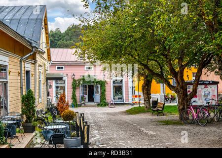 Porvoo, Finland - September 10 2018: Shops surround a small square and park in the medieval city of Porvoo, Finland. - Stock Image