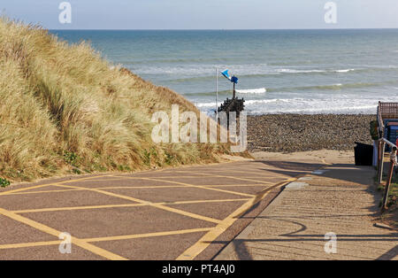 A view of the slipway to the beach on the North Norfolk coast at West Runton, Norfolk, England, United Kingdom, Europe. - Stock Image