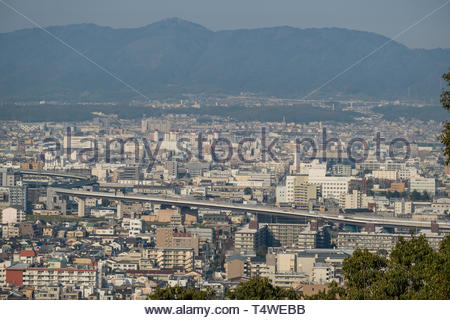View of urban Kyoto from hillside above Fushimi Inari Taisha Shinto shrine, Inariyamakanyuchi, Fushimi Ward, Kyoto, Honshu, Japan - Stock Image