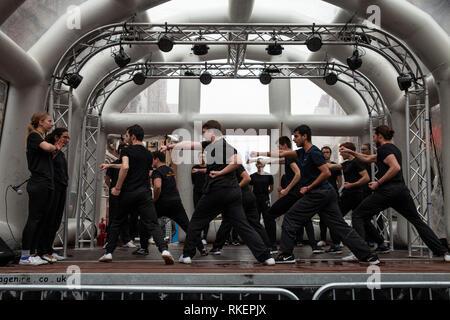 London, UK, 10 February, 2019. Chinese New year celebration at China Town, SOHO, London, UK. Martial Arts Group perfromance  on stage. Credit: Harishkumar Shah/Alamy Live News - Stock Image