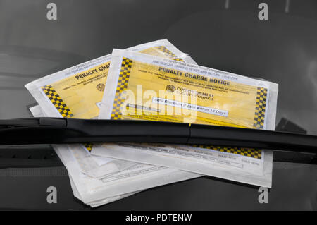 Oxfordshire Council's parking ticket on car windscreen - Stock Image