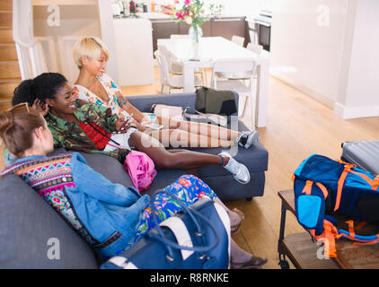 Young women friends with bags arriving at house rental - Stock Image