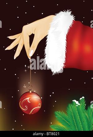 Santa Woman Hand Holding Christmas Bauble - Stock Image