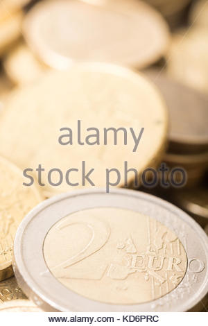 Macro of two euro money metal coin on the pile of metal euro coins. - Stock Image