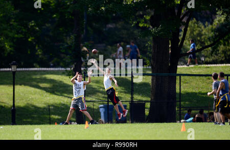 boys playing touch football in Central Park in New York City - Stock Image
