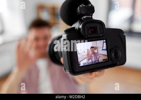 close up of camera recording male video blogger - Stock Image