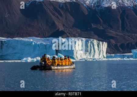Greenland, Scoresby Sund, Gasefjord. Zodiac and an iceberg. - Stock Image