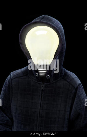 Mysterious man wearing hoodie in silhouette with a light bulb on his head isolated on black background. Concept of mystery, creativity, bright ideas,  - Stock Image