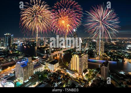 Beautiful fireworks celebrating loy krathong festival or New year along Chao Phraya River in Bangkok, Thailand - Stock Image