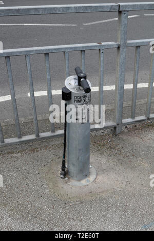 Roadside bicycle tyre pump - Stock Image