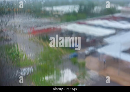 Monsoonal rain seen through a window in Darwin, Northern Territory, Australia. - Stock Image