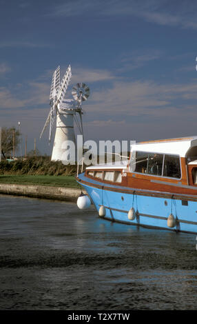 Morse's Mill and old boat in Thurne Dyke, Norfolk, England - Stock Image