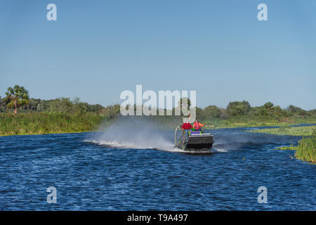 Girl Operating Airboat in Central Florida USA - Stock Image