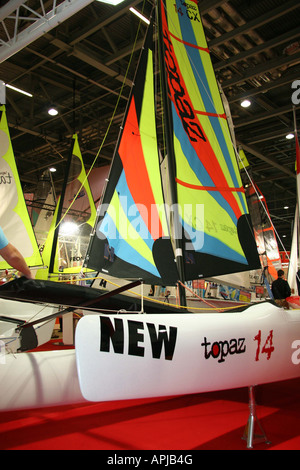 Topaz 14 small sailng boat  with multi coloured sail - Stock Image