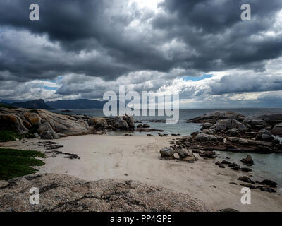 Sandy beaches and boulders on the shores of False Bay, near Cape Town, South Africa - Stock Image