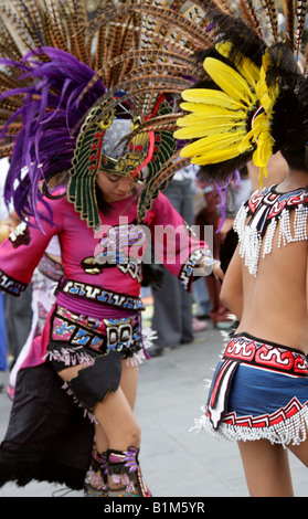 Young Mexican Girl Dancing in Aztec Costume, Zocalo Square, Plaza de la Constitucion, Mexico City, Mexico - Stock Image