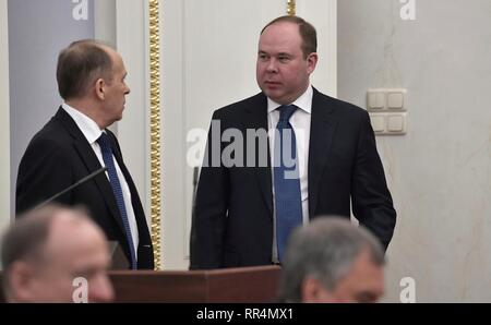Moscow, Russia. 22nd Feb, 2019. Russian Federal Security Service Director Alexander Bortnikov, left, chats with Presidential Chief of Staff Anton Vaino, right, before the start of the permanent members of the Security Council of the Russian Federation meeting at the Kremlin February 22, 2019 in Moscow, Russia. Credit: Planetpix/Alamy Live News - Stock Image