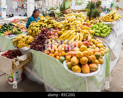Cusco, Peru - January 3, 2017. View of a woman selling fruit in a store of the Cusco market - Stock Image