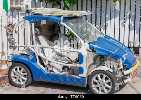 A severely beaten car in Gustavia, St Barts - Stock Image