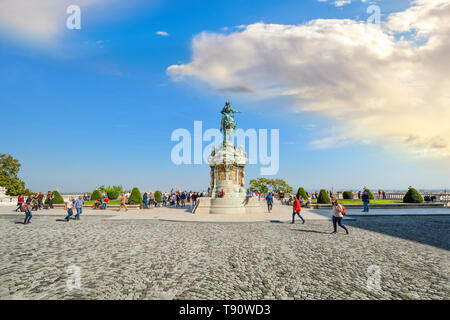 Tourists near the equestrian statue of Prince Savoyai Eugen on the terrace in front of the Royal Palace at the Buda Castle Complex in Budapest Hungary - Stock Image