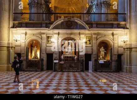 Malaga Cathedral Interior - the Chapels of the Retrochoir, and a tourist taking a photo, Malaga Cathedral, Malaga, Andalusia Spain - Stock Image