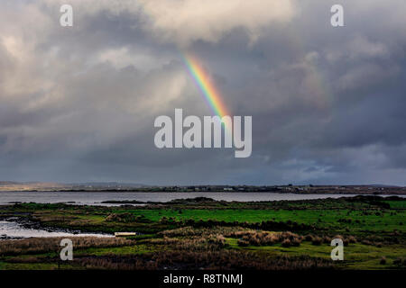 Ardara, County Donegal, Ireland. 18th December 2018. After a night of heavy rainfall a rainbow appears on the north-west coast. The day continues with sunny spells and heavy rain showers. Credit: Richard Wayman/Alamy Live News - Stock Image