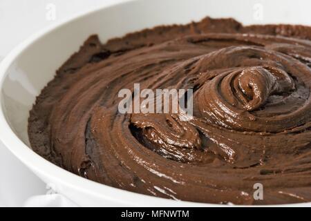 Close-up of chocolate mix in white porcelain bowl. Studio shot.       Ref: CRB538_103609_0028  COMPULSORY CREDIT: Martin Harvey / Photoshot - Stock Image