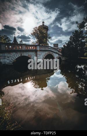 Bridge in palace garden Laxenburg near Vienna in summer - Stock Image