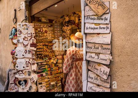 Tourist in souvenir shop, Siena, Tuscany, Italy - Stock Image
