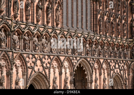 Ornate west front of Lichfield Cathedral England showing statues of Kings renovated in Victorian era by Sir George - Stock Image
