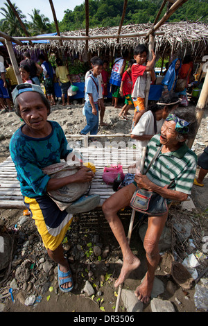 Hanunoo Mangyan men at a Mangyan market near Mansalay, Oriental Mindoro, Philippines. - Stock Image