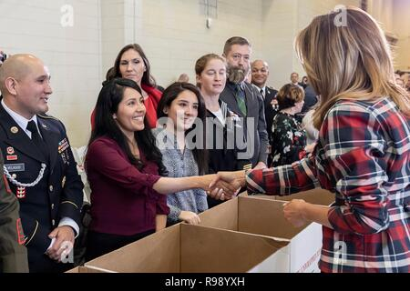U.S. First Lady Melania Trump meets with volunteers during a Toys for Tots Christmas Event at Joint Base Anacostia-Bolling December 11, 2018 in Washington, DC. Toys for Tots is a Marine Corps Program that collects new unwrapped toys and distribute those toys to less fortunate children at Christmas. - Stock Image