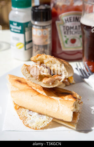 Breakfast snack of fried egg and sausage baguette served in a Tapas bar/cafe in Fuengirola, Spain. - Stock Image