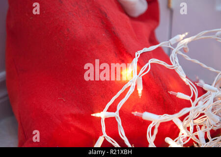Santa sack and white holiday lights - Stock Image