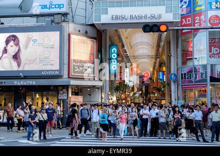 Busy street scenes in Osaka, Japan - Stock Image