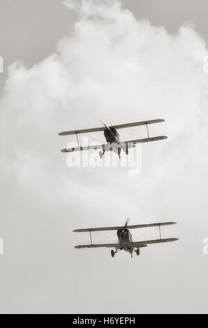 bi-plane in flight during an air show - Stock Image