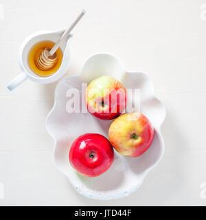 Apples, pomegranate and honey for Rosh Hashanah - Stock Image