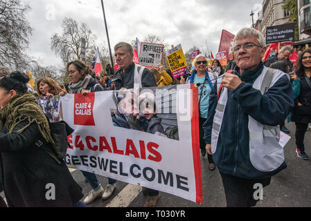 London, UK. 16th March 2019. Care4Calais banner supports trapped refugees on the march by thousands through London on UN Anti-Racism day to say 'No to Racism, No to Fascism' and that 'Refugees Are Welcome Here', to show solidarity with the victims of racist attacks including yesterdays Christchurch mosque attack and to oppose Islamophobic hate crimes and racist policies in the UK and elsewhere. The marchers met in Park Lane where there were a number of speeches before marching to a rally in Whitehall. Marches took place in other cities around the world including Glasgow and Cardiff. Peter Mars - Stock Image