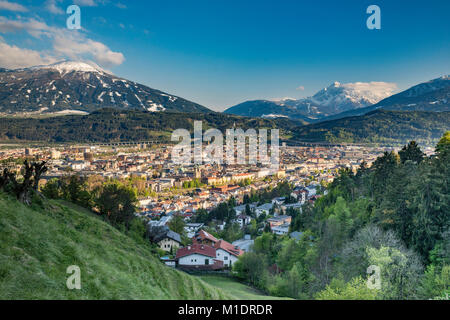Center of Innsbruck in Lower Inn Valley, Grosse Loffler massif in Zillertal Alps covered with snow in late April - Stock Image