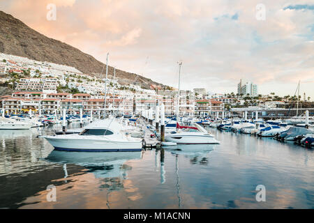The marina in the harbour of Los Gigantes, a tourist resort in western Tenerife, Canary Islands, Spain - Stock Image