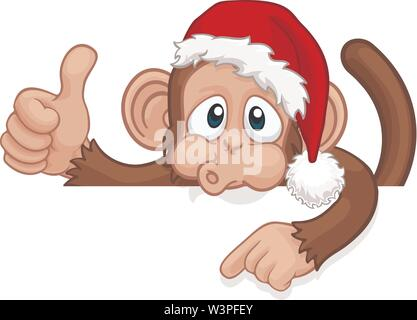 Christmas Monkey Cartoon Character in Santa Hat - Stock Image