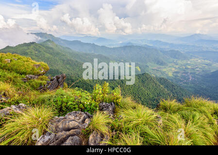 Beautiful landscape nature high mountain forest and sky of the Phi Pan Nam Range during winter from viewpoint Phu - Stock Image