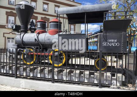 Model Exhibit of Old Locomotive Railroad Steam Engine in Museo Ferroviario, an outdoor Rail Museum in Camaguey Cuba - Stock Image