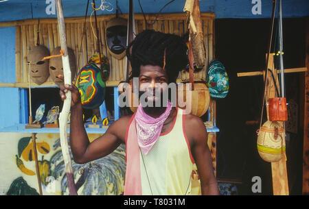 Grenadian craftsman outside his shop in Grenada. Caribbean - Stock Image