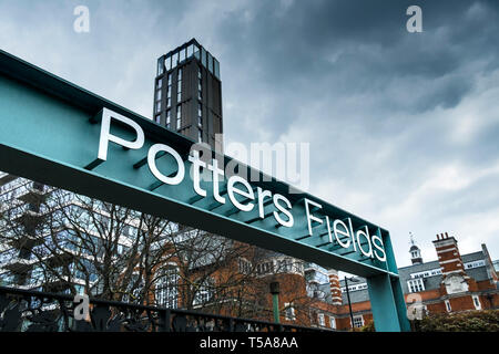The metal sign above an entrance to Potters Fields in London. - Stock Image