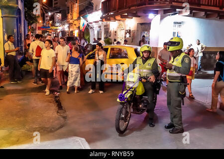 Cartagena Colombia Old Walled City Center centre Getsemani night nightlife Hispanic resident residents tourism police motorcycles public safety pedest - Stock Image